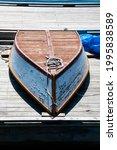 Wooden rowboat resting upside...