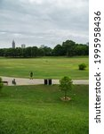 Small photo of Atlanta, GA, USA- June 19,2021: Early morning people jogging, biking and walking their dogs along Atlanta belt line with a panoramic view of Atlanta skyline and Piedmont park post pandemic reopening