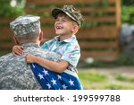 Military Man Father Hugs Son....
