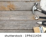 set of tools on wood panel... | Shutterstock . vector #199611434