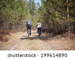 women and boy biking on forest... | Shutterstock . vector #199614890