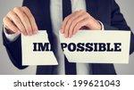 businessman tearing up a sign... | Shutterstock . vector #199621043