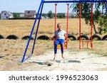 Defocus Little Girl Swinging On ...