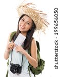 Small photo of Portrait of pretty female traveller holding airplane ticket