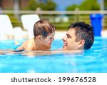 happy family in summer pool | Shutterstock . vector #199676528