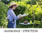 senior woman puts on gloves in... | Shutterstock . vector #199679156