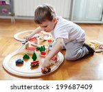 Little Boy Playing With Wooden...