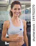 fit woman smiling at camera... | Shutterstock . vector #199702370