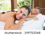 calm friends lying on massage... | Shutterstock . vector #199702568