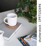 On white table  white mug...