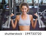 fit smiling woman using the... | Shutterstock . vector #199733720