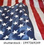 usa flag  close up. studio shot.... | Shutterstock . vector #1997369249