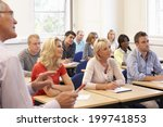 senior tutor teaching class | Shutterstock . vector #199741853