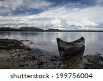 A Dugout Canoe Lays On A Remot...