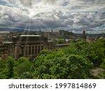 Small photo of The misalliance over Edinburgh. Edinburgh, Scotland - July 27, 2017 A remarkable combination of cloudy skies and sunlight over Edinburgh.