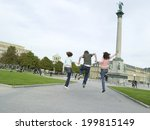 young people jumping  hand in... | Shutterstock . vector #199815149