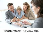 family signing home purchase... | Shutterstock . vector #199869506