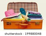 packed vintage suitcase full of ... | Shutterstock . vector #199880048