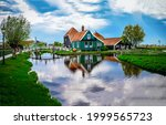 A House In The Village By The...