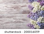Lilac Flowers On Wood...