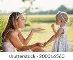 happy young mother having fun... | Shutterstock . vector #200016560
