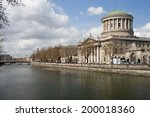 Four Courts by the river Liffey in the city of Dublin in Ireland. - stock photo