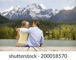 Senior Couple Sitting On Pier...