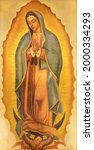 Small photo of VIENNA, AUSTIRA - JUNI 24, 2021: The painting of Immaculate from Guadaluppe in the Votivkirche church by Hans Schweiger (1954).