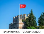 City fortress walls of Istanbul with turkish flag, Ruins of ancient fortress byzantine wall bastion istanbul. Theodosius castle wall near golden horn.