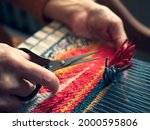 Master Weaver Is Cutting The...