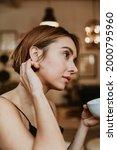 woman having a coffee in her... | Shutterstock . vector #2000795960
