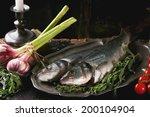 tow raw fish seabass served... | Shutterstock . vector #200104904