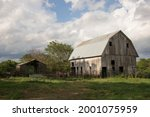 Old Weathered Barn In Tall...