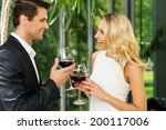 cheerful couple with glasses of ...   Shutterstock . vector #200117006