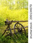 Old Wagon Wheel Next To A...