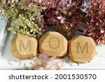 Word Mom Written On Wooden...