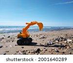 Yellow Bulldozer On The Beach...