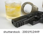 Glass Of Whiskey And Gun...