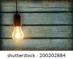 light bulb lamp on wooden...   Shutterstock . vector #200202884