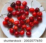 red ripe macro cherries on a... | Shutterstock . vector #2002077650