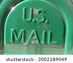 Green US Mail bin for relay mail depot under the strong summer sunshine in Bloomfield, NJ