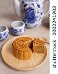 moon cake slice on wooden dish... | Shutterstock . vector #2002241903