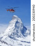 Постер, плакат: Helicopter flew over Matterhorn