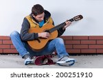 Handsome Man Playing Guitar On...