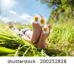 child with daisy between toes... | Shutterstock . vector #200252828