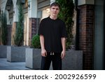 mockup of a black t shirt on a... | Shutterstock . vector #2002926599