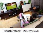young couple relaxing  watching ... | Shutterstock . vector #200298968