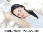 beautiful girl lying in a... | Shutterstock . vector #200322830