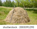 A Haystack In A Clearing On A...