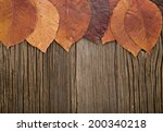 leaves on a wooden background | Shutterstock . vector #200340218